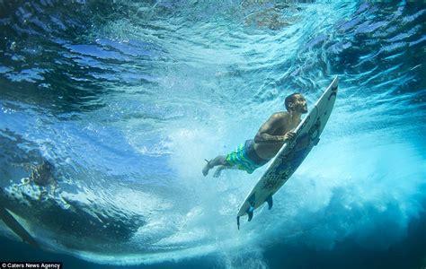 fantastic photographs  surfers mastering  waves