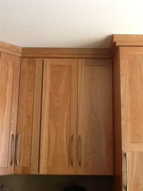 cabinet in a sentence crown molding pairs well with shaker style cabinetry