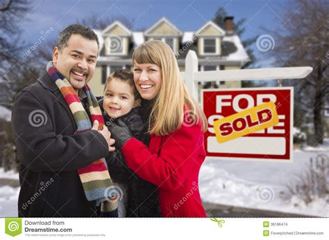 family  front  sold real estate sign  house stock