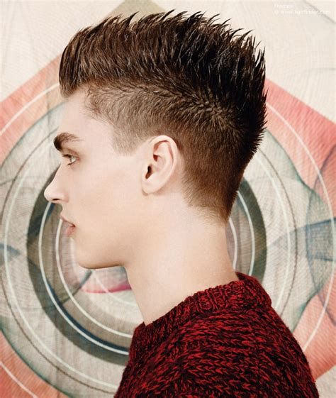 Short men's hair in a hedgehog style with sharp spikes