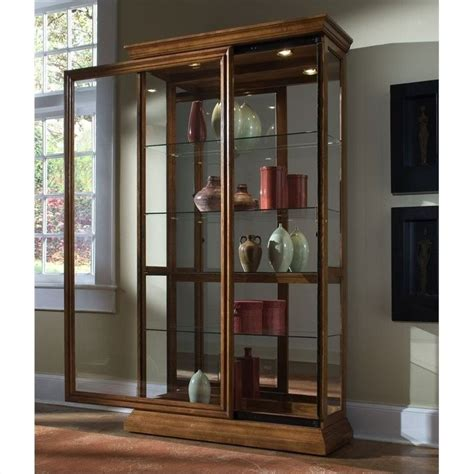 sliding door curio cabinet pulaski 2 way sliding door curio cabinet in golden oak 20544