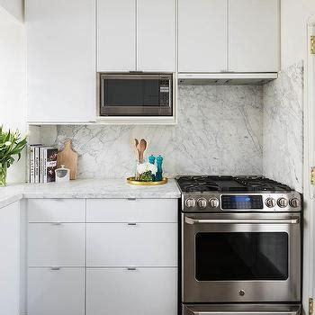 Kitchen Mosaic Backsplash Ideas - hidden range hood design ideas