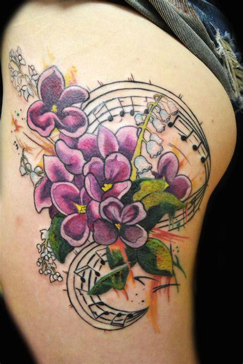 adrienne haberl tattoos thigh piece flowers