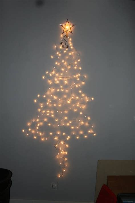make a christmas tree on the wall with just a strand or