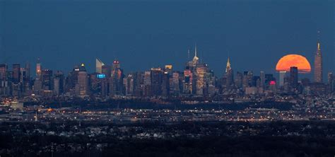 Full moon rises behind New York City