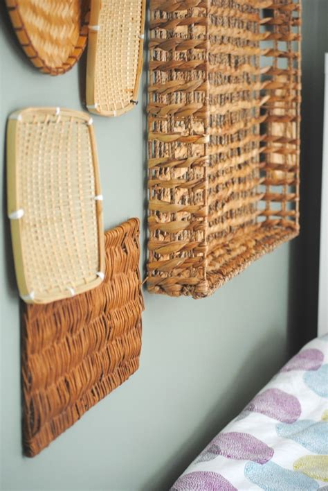 Wall baskets are extremely popular for decorating an entryway, just hang them over your benches or poufs. How to Hang a Basket Wall {15 Min. Decor, Day 10}   Making Lemonade