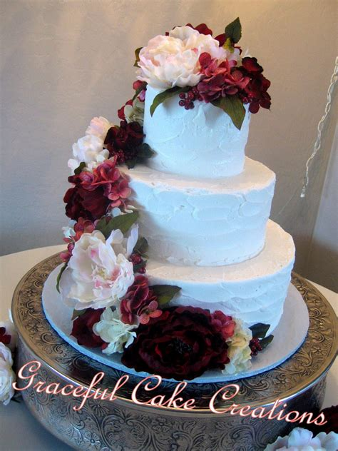 elegant textured butter cream wedding cake accented
