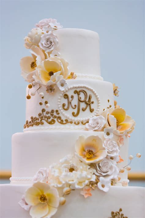 Three Tiered Ivory and Gold Wedding Cake with Floral Accents   Beautiful Tampa Weddings