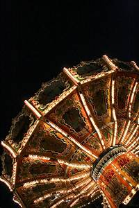 Photograph Bright Circus Carnival Amusement Park Lights in the