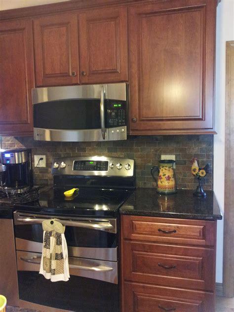cherry cabinets tan brown granite counter copper rust
