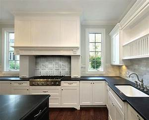 honed black countertops transitional kitchen With kitchen colors with white cabinets with beautiful black and white wall art