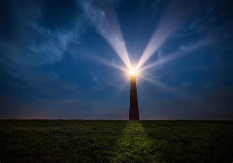 photo lighthouse sea night coast light sky beacon
