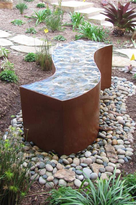 rusted metal water features  ten steel water feature