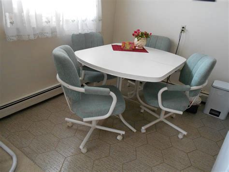 Kitchen Table And Four Swivel Chairs (table Extension