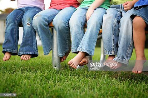 Barefoot Boy In Jeans Stock Photos And Pictures