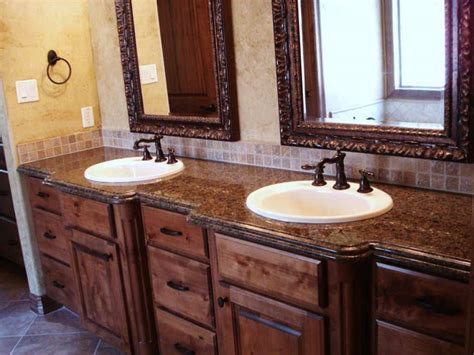 tuscan bathroom  wooden vanities  granite
