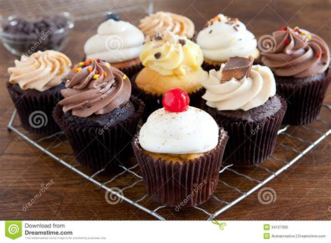 cupcakes iced  cooling rack stock photo image
