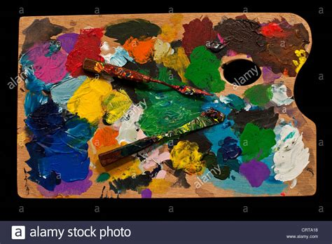 artist palette with paint knife for mixing paints stock