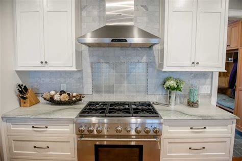 kitchen range hood backsplash cararra marble subway tile