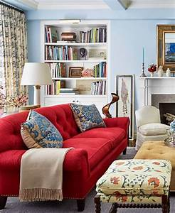 Living Room With Blue Walls And A Red Sofa Decorating ...