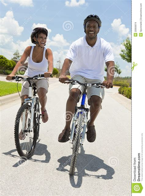 black cycling african american man woman couple cycling stock images