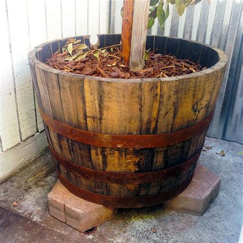 whiskey barrel planter how to prepare a whiskey barrel for planting