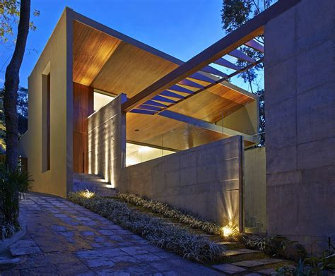 Luxurious Home Uses Wood And Elements To Interiors And Exteriors contemporary homes exterior steel building designs steel