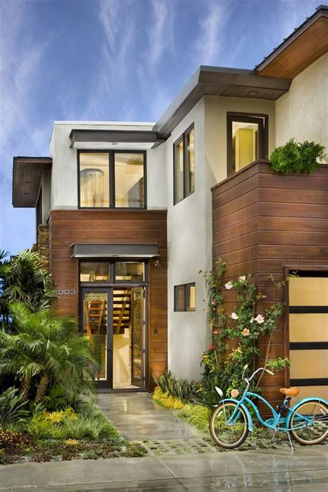 2 Simple Modern Homes With Simple Modern Furnishings by Modern House With Stucco And Horizontal Wood Slat Exterior