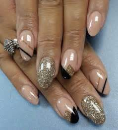 Beige gold glitter and black nail art design