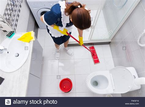 Bathroom Floor Cleaner by Housekeeper In A Hotel Mopping A Floor In A Clean White