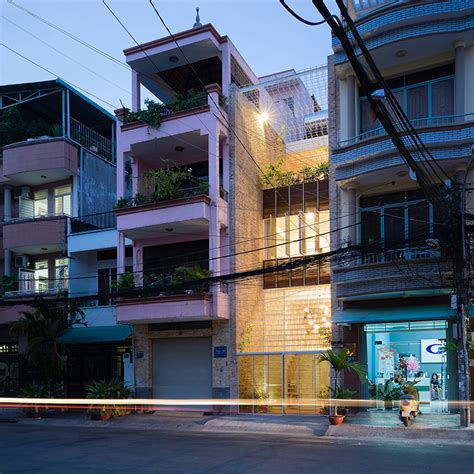 white grid inserted  vietnamese townhouse  block
