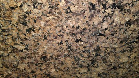 desert brown granite great contrast with white cabinets