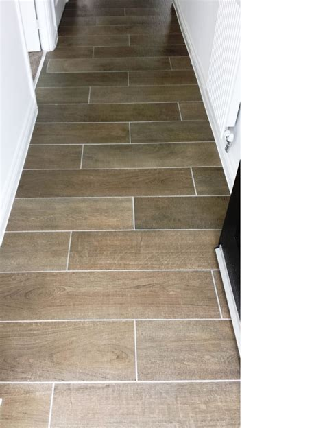 grout removed from wood effect porcelain floor tiles