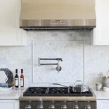white kitchen  gray wash wood tile floors