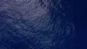 Top view of dark blue ocean water and tropical surface ...