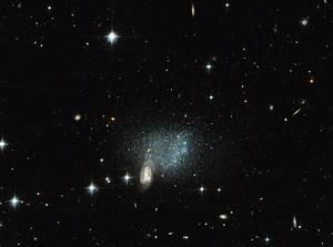Hubble Image Shows Distant Galaxies Colliding