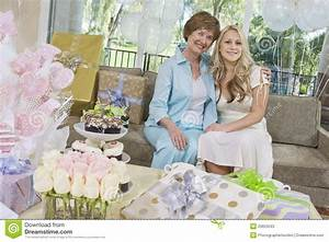Mother And Daughter Sitting On Sofa At Hen Party Stock ...