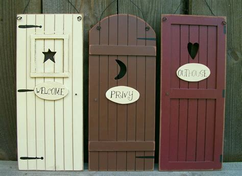 primitive bathroom wall decor set 3 primitive country quot outhouse quot door signs quot welcome