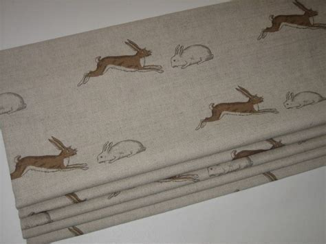 Roman blind in Rabbits and Hares fabric from Emily Bond