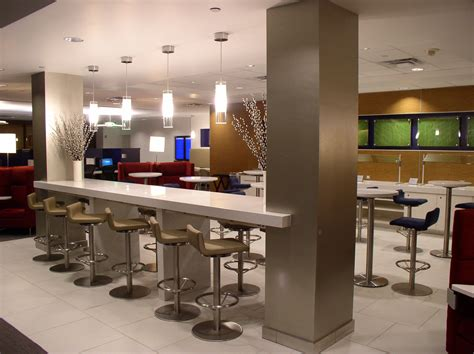 delta sky lounge features tables in cloud white zodiaq quartz