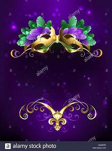 Mardi Gras gold mask of green and purple feathers on a ...