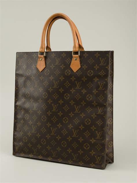louis vuitton leather monogram flat sac bag  brown lyst
