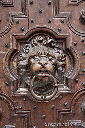 antique lion head door knocker  wooden door royalty