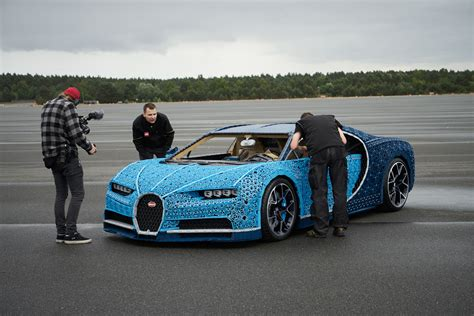 A real bugatti chiron will set you back $2.5 million, but this one cost just 1,000,000 bricks… and 2,304 lego power function motors… and 4,032 technic gears. LEGO Technic Bugatti Chiron Life-Size Model-51   The Brothers Brick   The Brothers Brick
