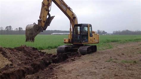 deere excavator digging ditch  drain tile youtube