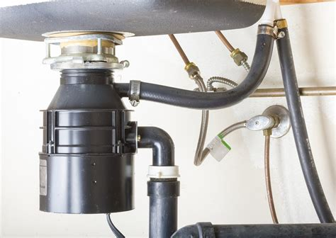 clogged kitchen sink with garbage disposal unclog a clogged garbage disposal a few tips to unclog it