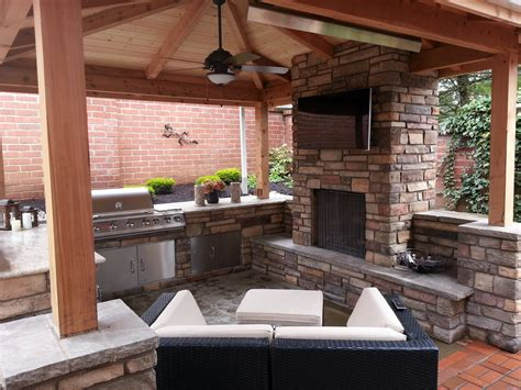 covered patio fireplace outdoor fireplace outdoor living outdoor kitchen covered patio granite countertops stone