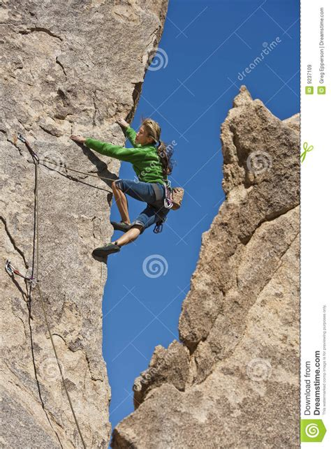 Female Rock Climber Stock Image Committed