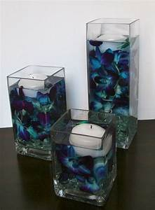 Floating candle centerpieces. Weddings. Blue dendrobium ...