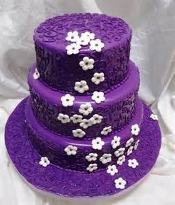 purple wedding cake purple wedding cake with white flowers